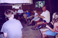 The family is being taught djambe drums