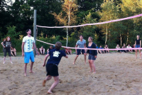 Children and youth are having fun with a game of beach volleyball