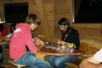 The youth are having a game of cards in the youth pavillon