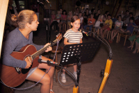 Childrens music evening where the youth are happy to play along