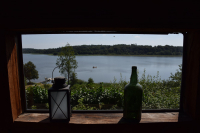 View from the common room to campers swimming in the lake