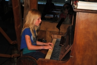 Children are also happy to play music - here a girl a the piano