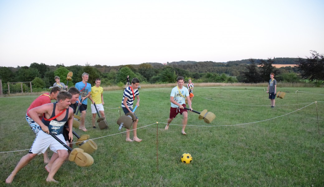 Children and youth are playing Kapow - a funny acticity on the sports field