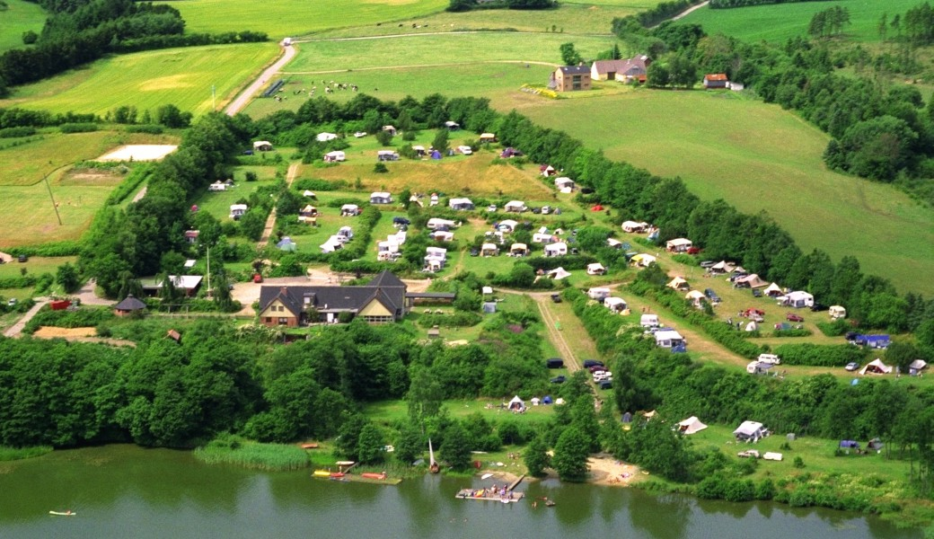 Aieral view over Vammen Camping. South facing pitches with a beautiful view over lake, forrest and nature