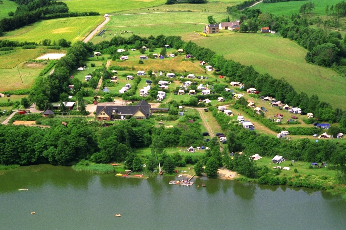 Aerial view of Vammen Camping and the beautiful sight over the beach, the water and its sourounding nature