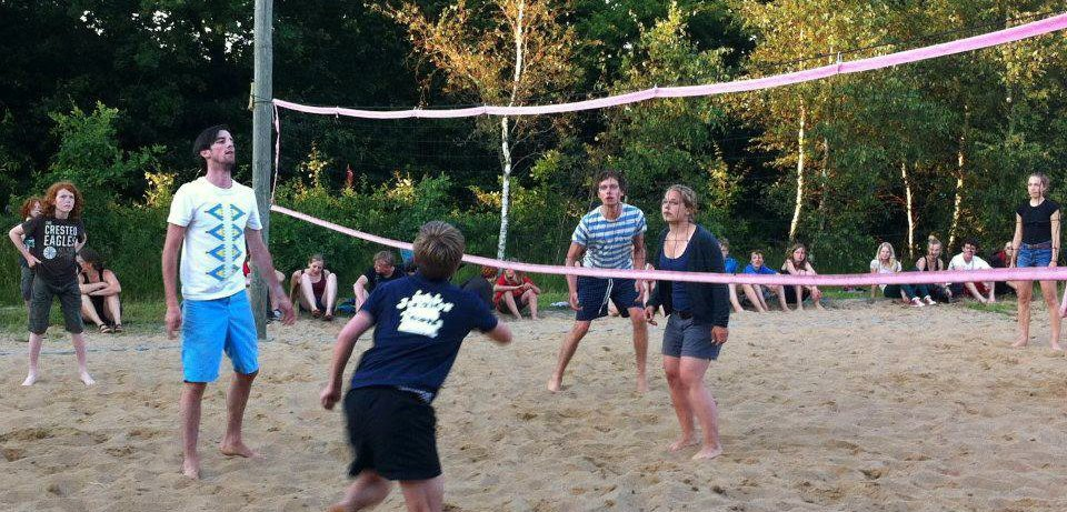 Children and youth are playing beach volley