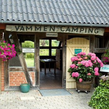 The entrance to Vammen Camping and the information decorated with flowers.